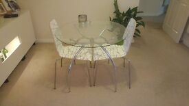 Stunning glass table and 2 chairs.