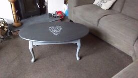 Solid wooden coffee table in greys with shabby chic heart detail. Quality