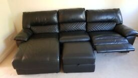 Black leather sofa and foot stool.