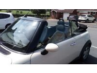 Low mileage Mini Cooper Convertible 2007 in ivory white.