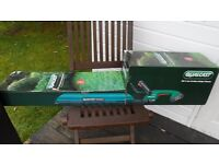 brand new qaulcast battery hedge trimmers