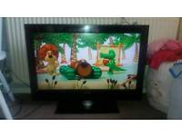 """32"""" Philips tv with glass stand"""