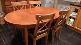 Old style mahogany oval table (needs some TLC) and 4 new IKEA chairs