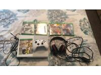 White slimline Xbox one with games and accessories