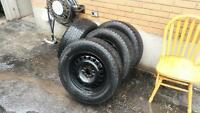 4 sport utility winter tires and rims for sale (used)