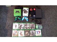 X Box One, with games, charging deck, 2 controllers and skins
