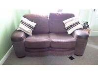 Two seater sofas good condition brown material