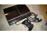 PS3 60GB. Plays ps1 and 2 games. Working.