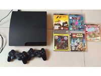 PS3 with 2 conrollers, games and rifle