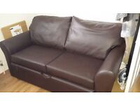 Sofa bed 2 seater in leather look with storage vgc fire resistant label attached