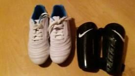 Football boots size 5 & nike shin pads small