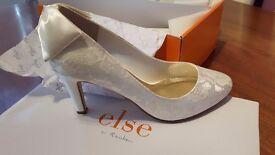 Ivory satin shoes size 5.
