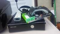X box console 2 games 2 wireless remotes and a headset