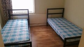 Two Single bed with metal frame and mattress
