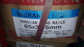 box of 65mm galvanized annular ring nails . I