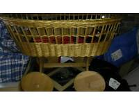 Wicker crib,moses basket with large wheels..