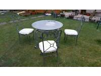 garden table with 4 seater.
