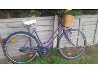 Ladies original Dutch style bike with wicker basket, back pedalling rear brake, suitable for anyone.