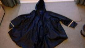 Waterproof poncho with sleeves