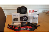 Canon 7D Mark 1 DSLR (Used,only 6586 activations) AND Canon BG-E7 Battery Grip (Used)