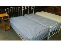 Metal framed single beds with mattreses