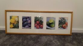 Prints of fruit in wooden frame