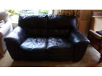 BROWN LEATHER 2 SEATER ITALIAN SOFA.