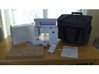 Janome Sewing Machine with quilting accessories and wheelie bag