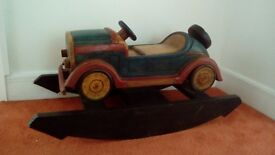 Solid wooden carved ride on vintage car