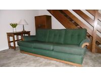 Ercol three-seater sofa and two armchairs