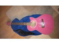 pink accoustic guitar