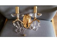 Beautiful double wall light in gold colour with crystal pieces