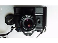 Nikon EM with 50mm lens and power grip.