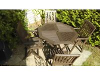 Garden table and four chairs ( two carvers and two regular)