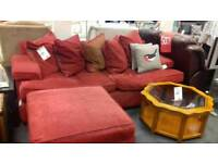 Red fabric sofa and footstool