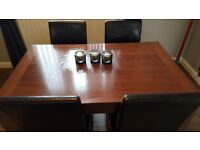 dark wood table and 4 chairs good condition