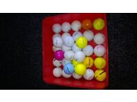 33 USED GOLF BALLS, VARIOUS MAKES.