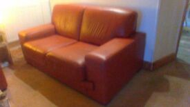 2x two seater sofas in light rust coloured leather