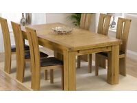 Solid Dining Table & 6 chairs 9mth old excellent condition cost over £2500