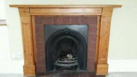 Wooden fire surround and mantle