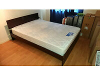 Second hand wooden double bed frame for sale