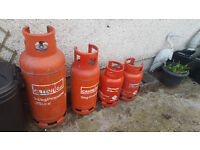 Empty propane gas tanks for sale.