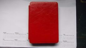 KINDLE CASE WITH LIGHT IN RED - BRAND NEW