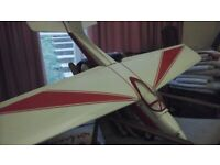 """Rc model plane,61""""span,good electric motor, prop and wheels.Downsizing so little used."""