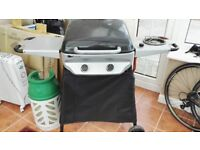 Gas BBQ with side hob and gas cylinder