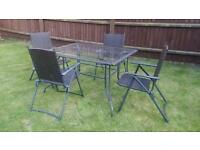 6 Folding Chairs + Large Patio Table rattan glass metal