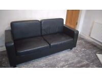 Black leather effect double sofa