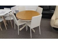 Julian Bowen Davenport Round Dining Table & 4 Jazz Stacking Chairs in Cream Faux Leather Can Deliver