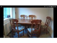 Solid dining table and 5 chairs.