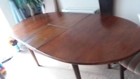 Oval mid oak extending dining table